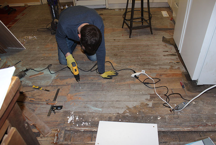 Hardwood kitchen floors during repairs