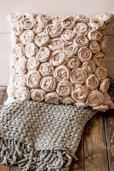 Textured pillow filled with canvas rosettes
