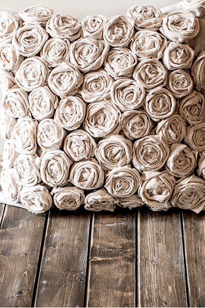 Completed textured pillow with 50 handcrafted canvas roses