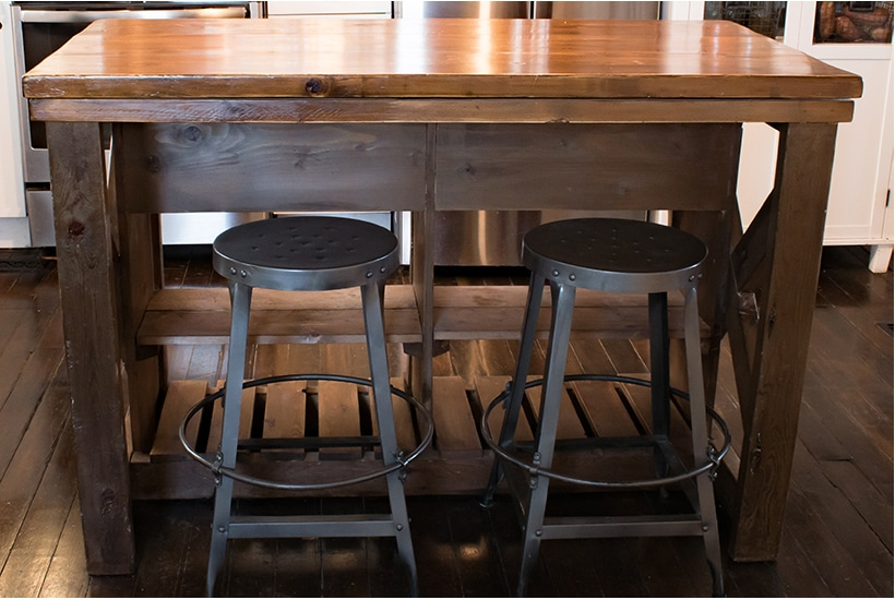 DIY wooden kitchen island with bar stools.