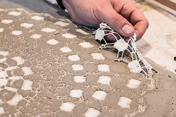 Removing the Doily from the DIY Concrete Clock Mold