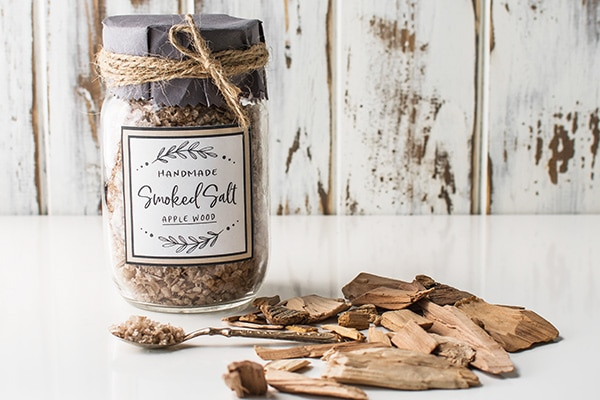 Jar of smoked salt with loose wood chips