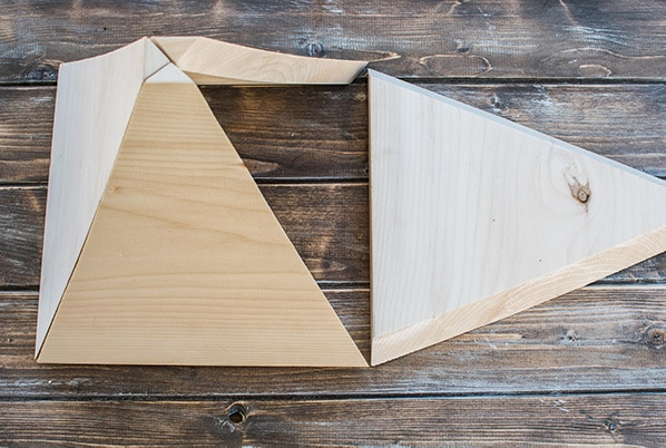 Triangle cut outs standing like a pyramid waiting for wood glue