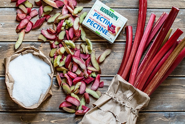 ingredients to make rhubarb jam on a rustic back ground