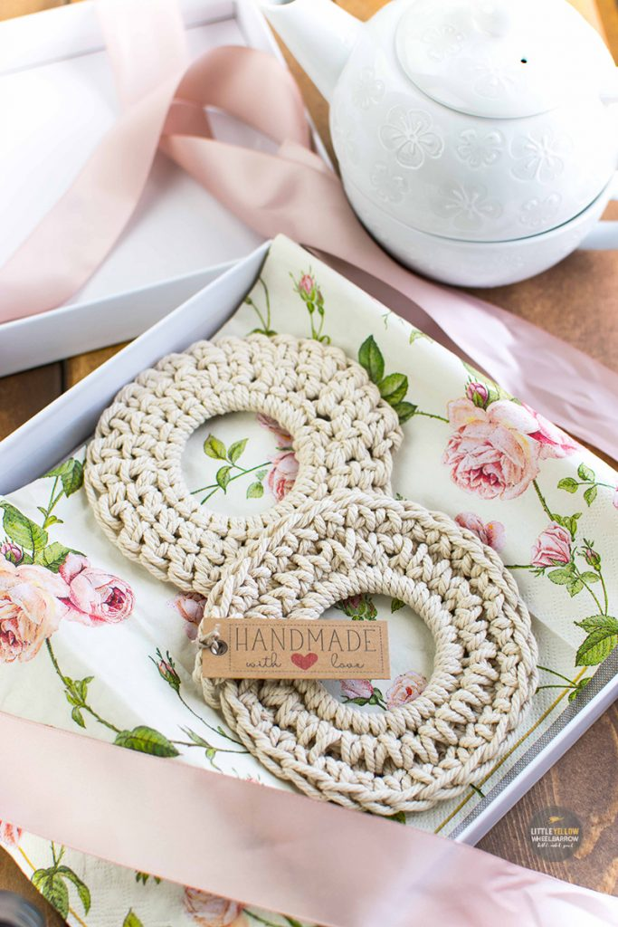 Crochet coasters in a gift box with floral tissue paper and pink satin ribbon