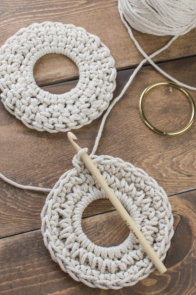 Crochet coasters on a wooden background