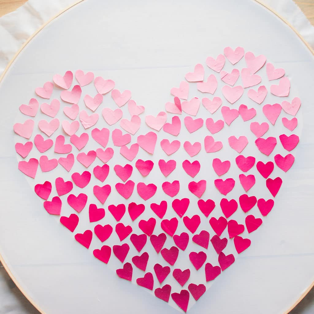 DIY embroidery hoop heart wall hanging with mini ombre hearts