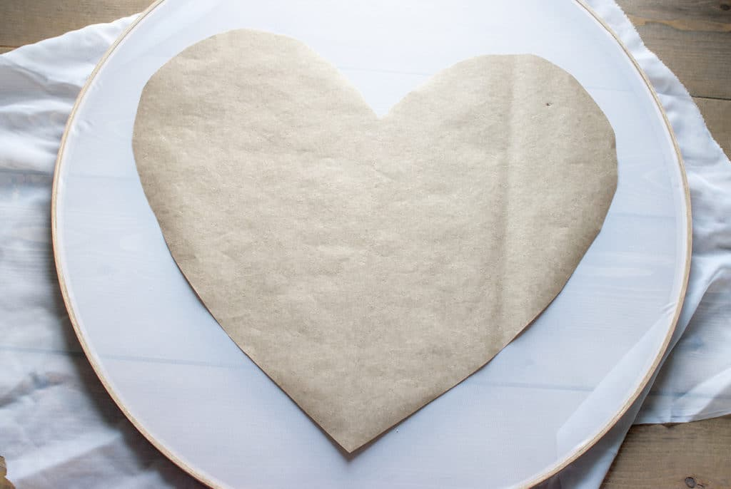Kraft paper heart on top of an embroidery hoop