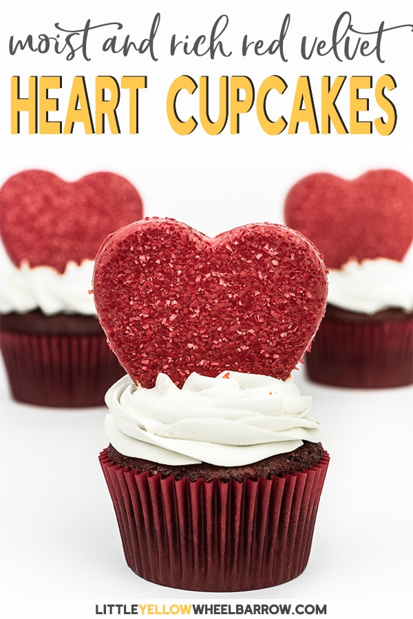 Pretty red velvet cupcakes with glitter chocolate hearts.  A perfect treat to make for Valentine\'s day.  These red velvet cupcakes are moist and rich and have a delicious cream cheese whip cream frosting. #cupcakes #redvevet #valentinesdaytreats #baking #redvelvetcupcakes #redvelvetcake