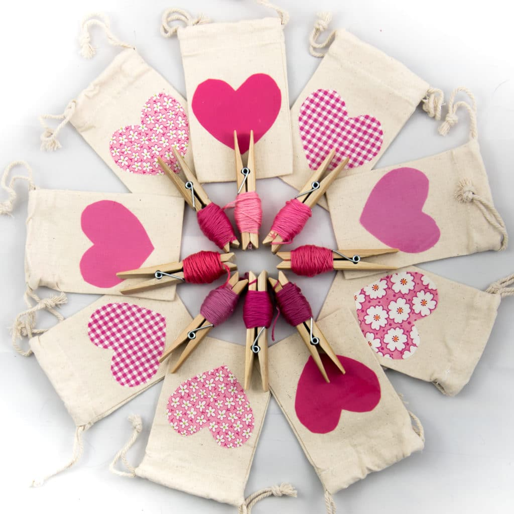 Canvas draw string bags with hearts in a circle