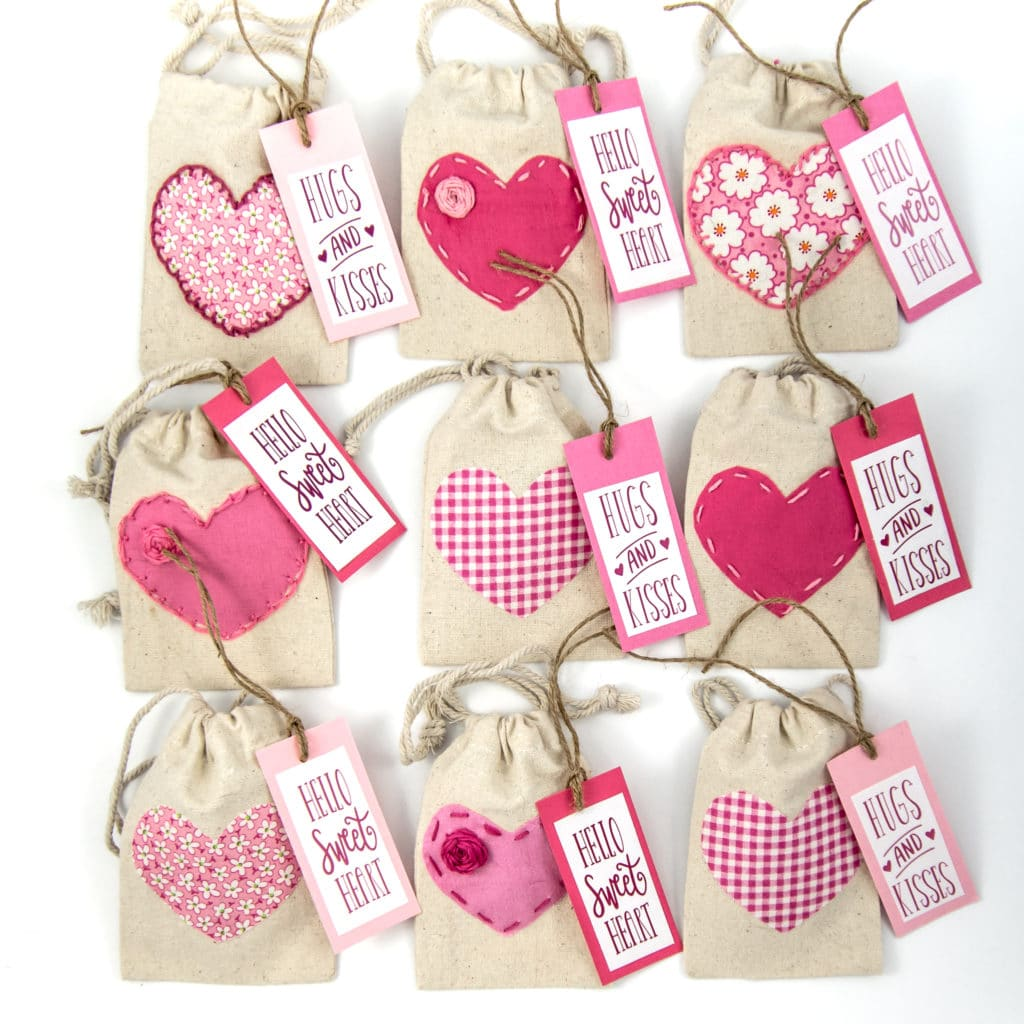 Valentine's day treat bags with pink hearts and gift tags