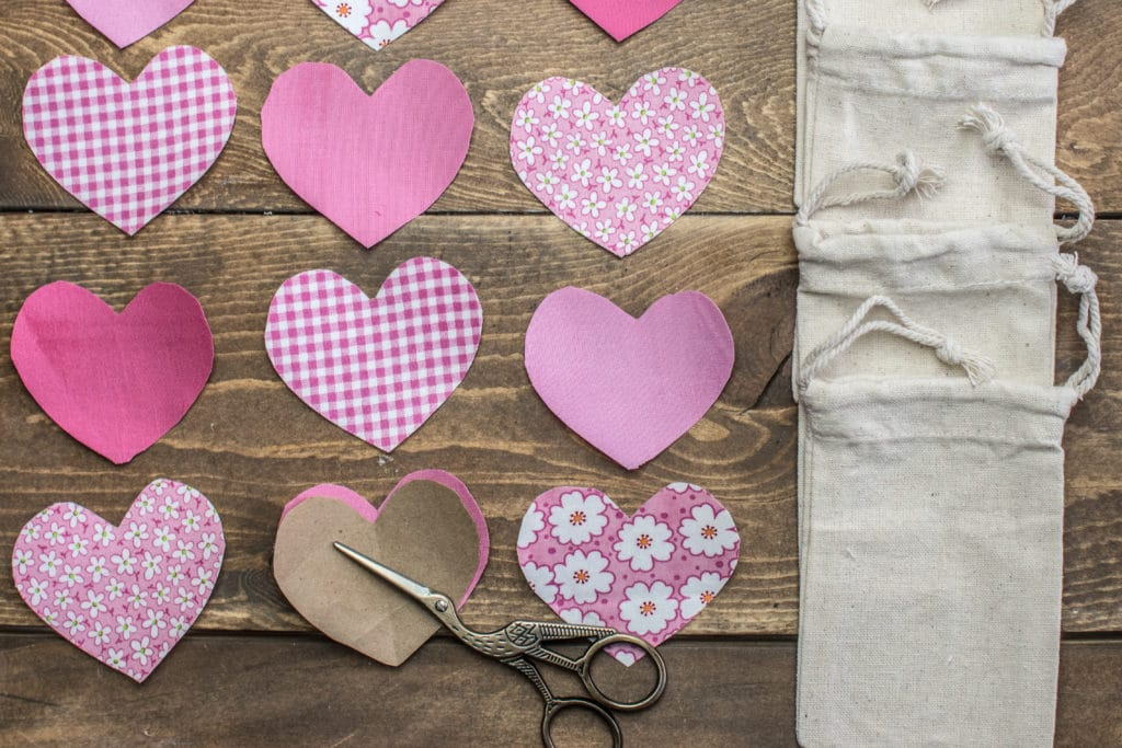 Pink pattern and pink solid fabric applique hearts with canvas tie string bags