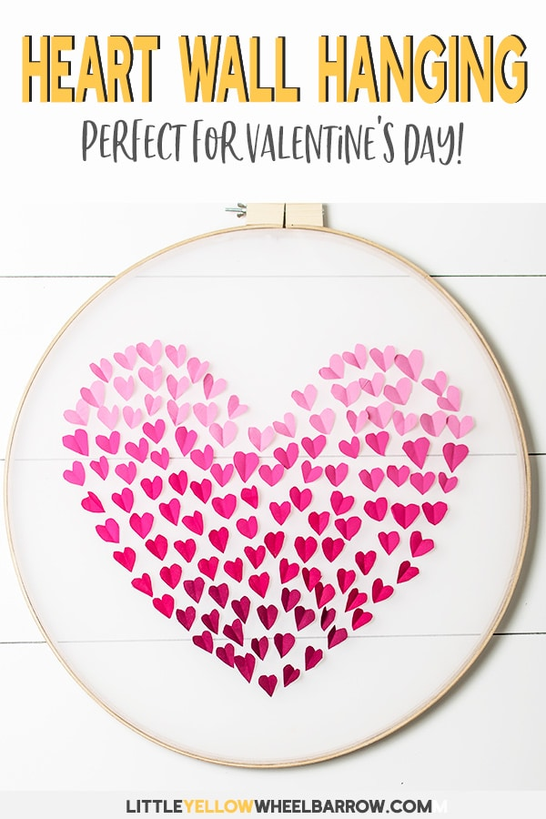 An easy craft project to make with an embroidery hoop. This ombre heart wall hanging is perfect Valentine's Day craft idea and would look super cute hanging on a door! Check out the step by step tutorial and make your own DIY embroidery hoop heart. #Valentinesdaycraft #easycraftideas #valentinesday #embroideryhoop #embroideryhoopcrafts