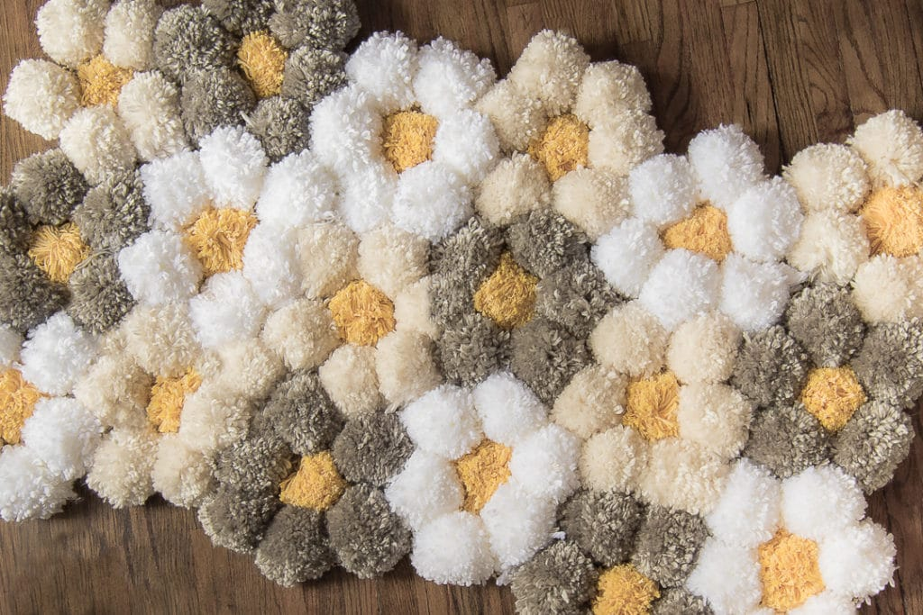 Daisy designed pom pom rug in grey, white and cream