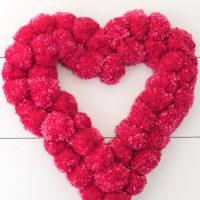 DIY Pom Pom Tutorial - Make this Pretty Heart Shaped Wreath!