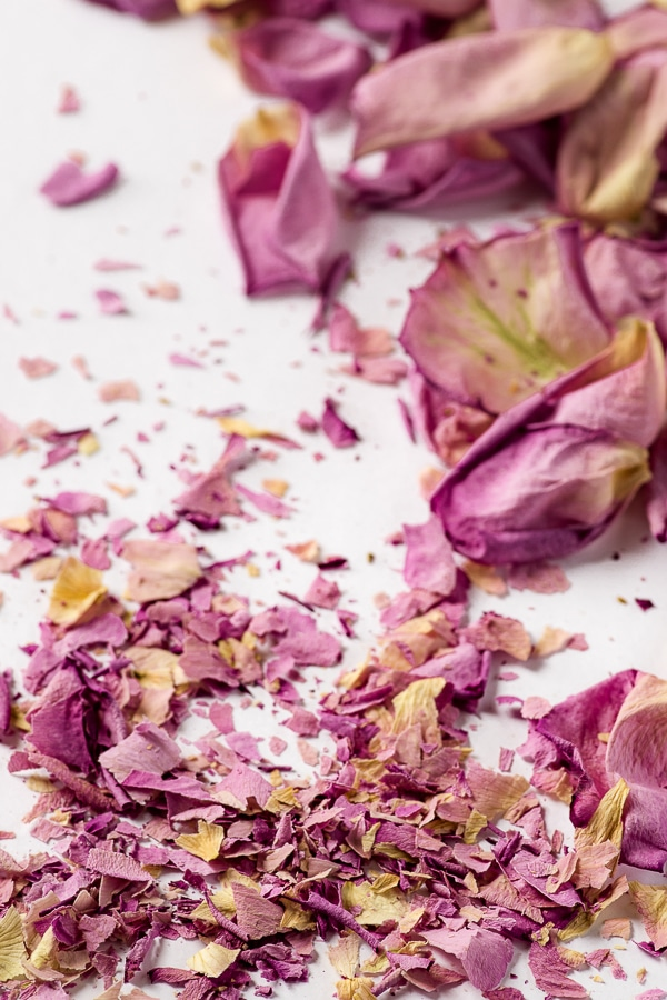 Dried lilac coloured petals crumbled into tiny confetti-looking pieces
