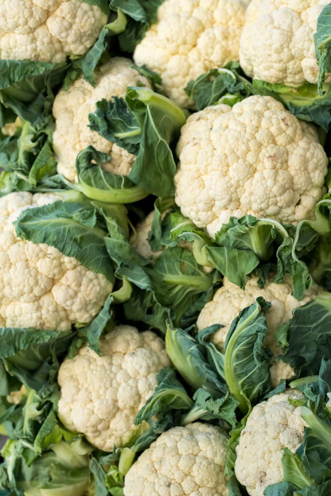 Heads of fresh cauliflower filling the photo edge to edge