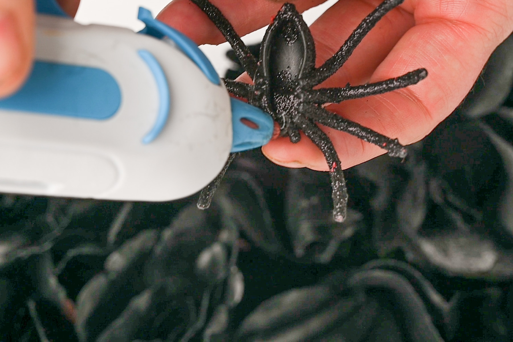 Glue gun with a plastic fake spider