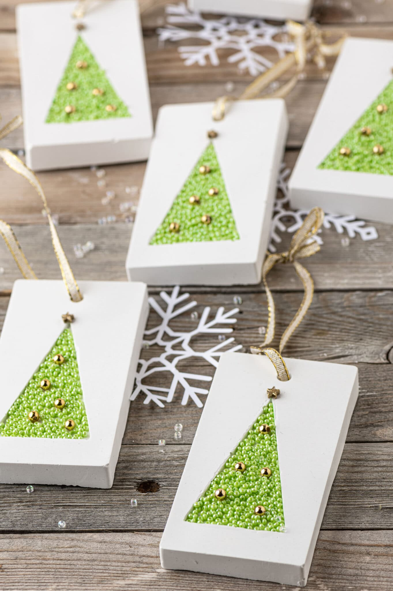 Plaster rectangle hanging tags with green beaded tree inlay