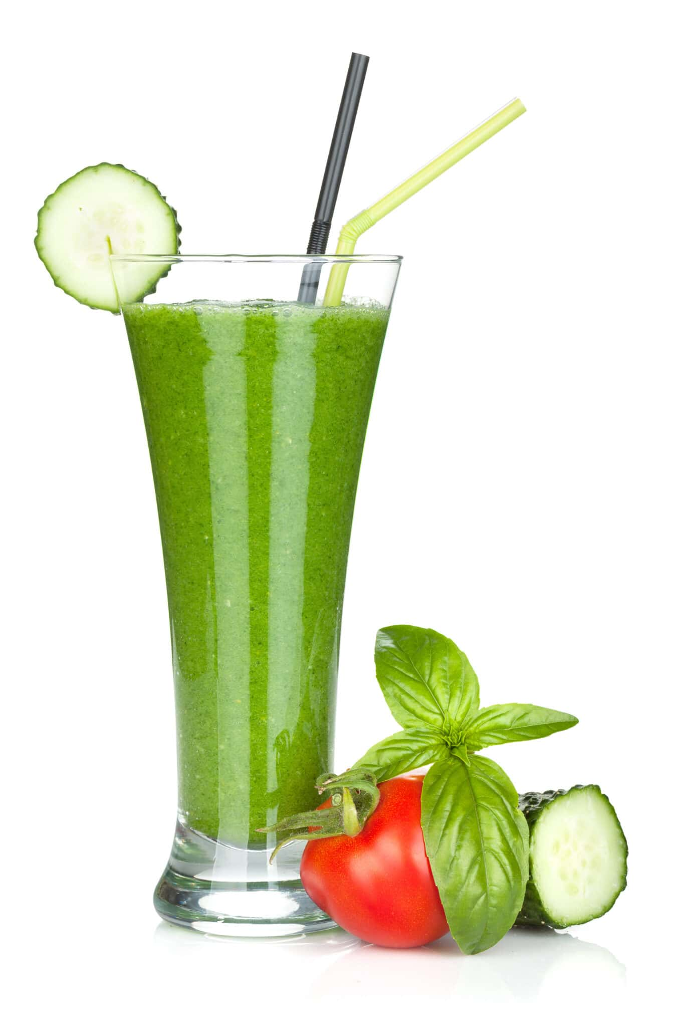 A tall cucumber smoothie with fresh vegetables.