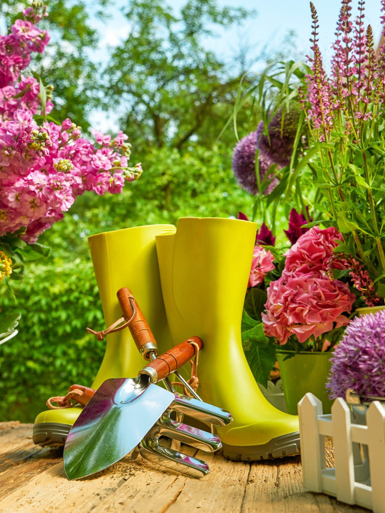Garden tools on an outdoor table.