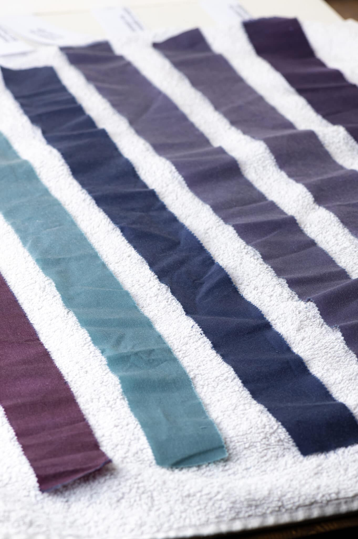 Strips of 100% cotton that have been coloured using a natural dye made from grapes. The colour is rich and vibrant, showing that natural fabrics take dyes very well.