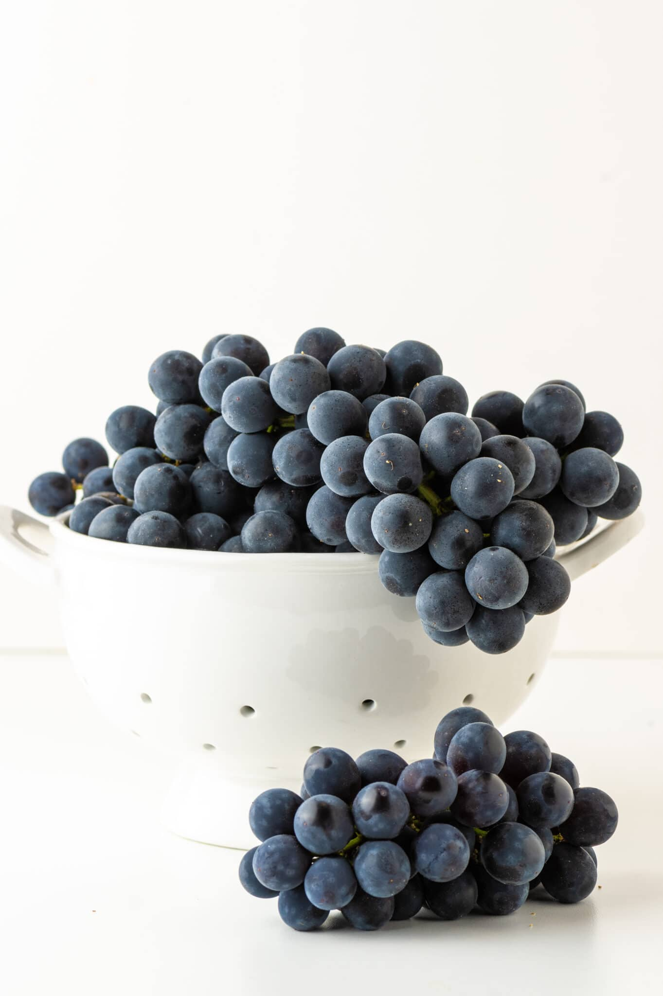 A bowl of purple grapes about to be used to make natural fabric dye.