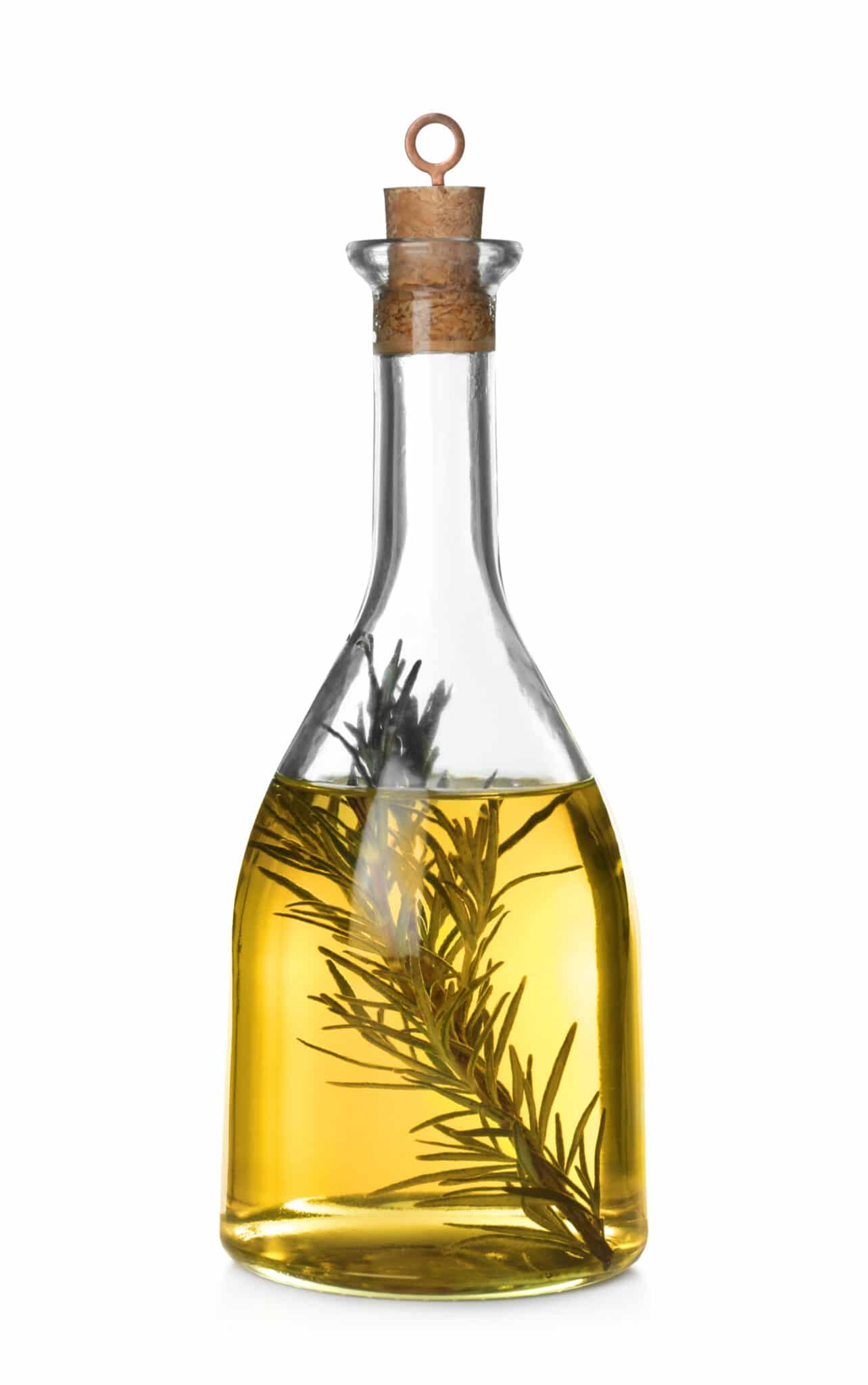 Cooking oil with rosemary in glass bottle isolated on white