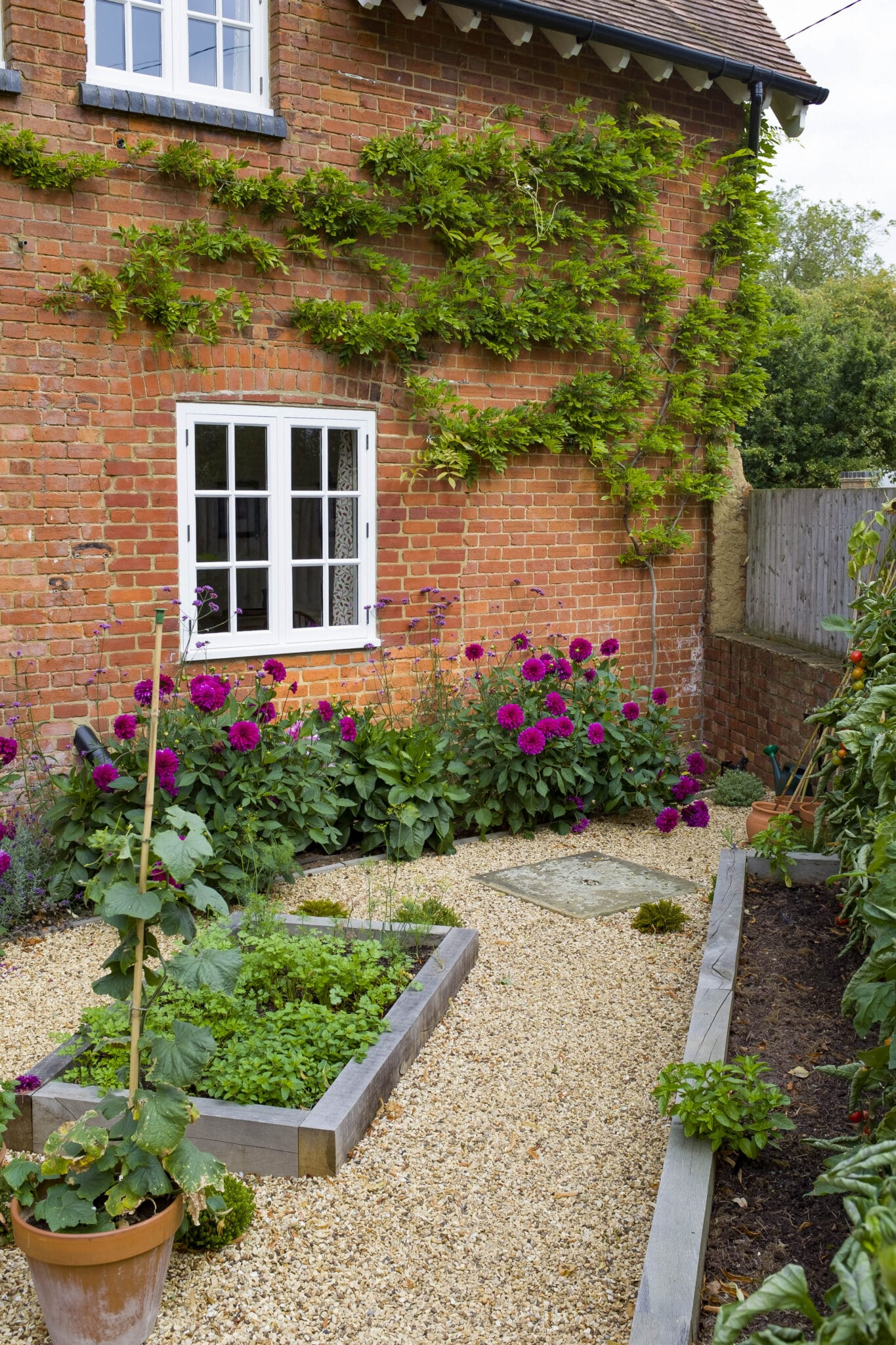A small backyard garden using raised beds, containers, and vertical gardening as garden ideas for small spaces.