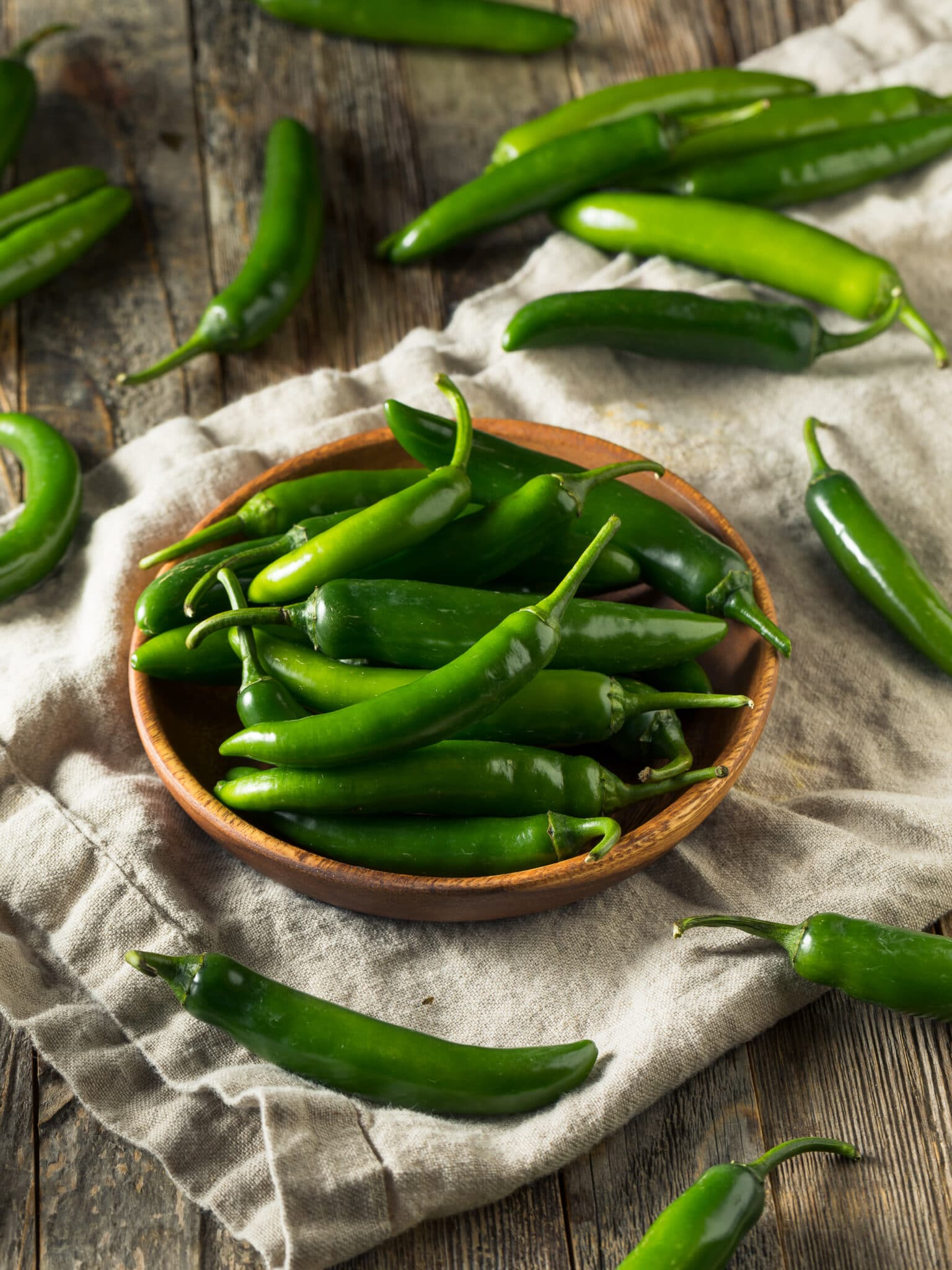 A small basket full of jalapenos.