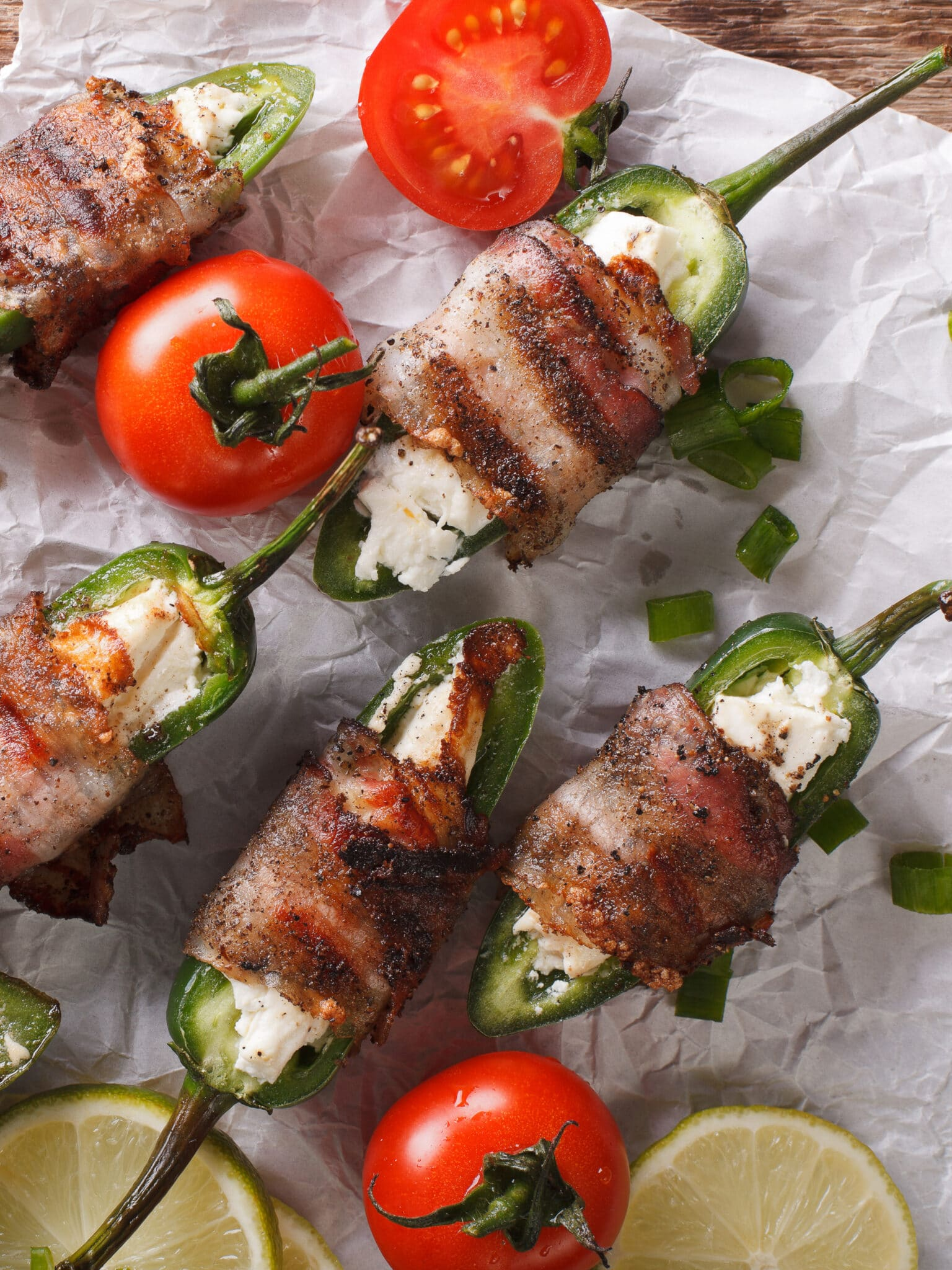 Creamcheese-filled jalapenos wrapped in bacon.