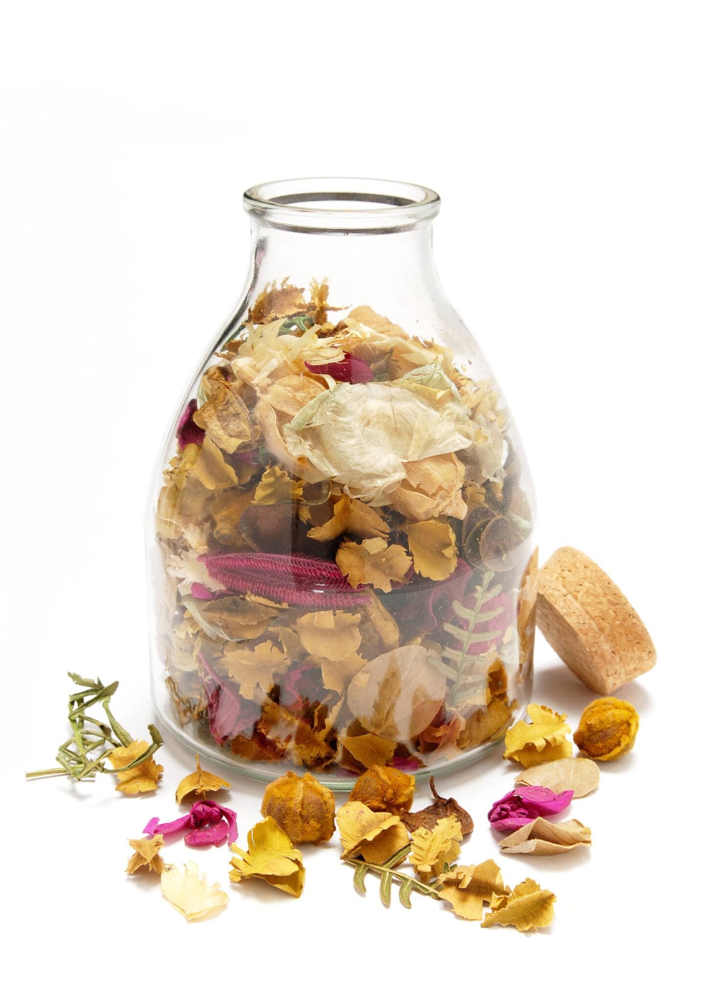 Jar of floral potpourri against a bright white background.