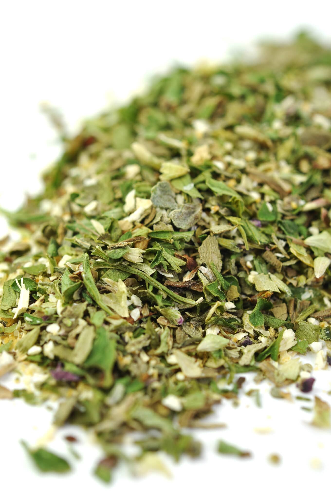 Dried herbs in a pile close up image.